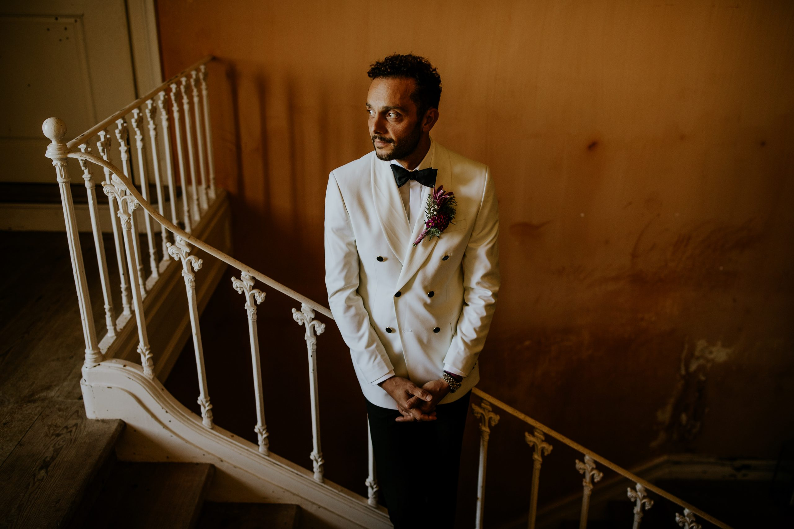 groom waiting for the first look