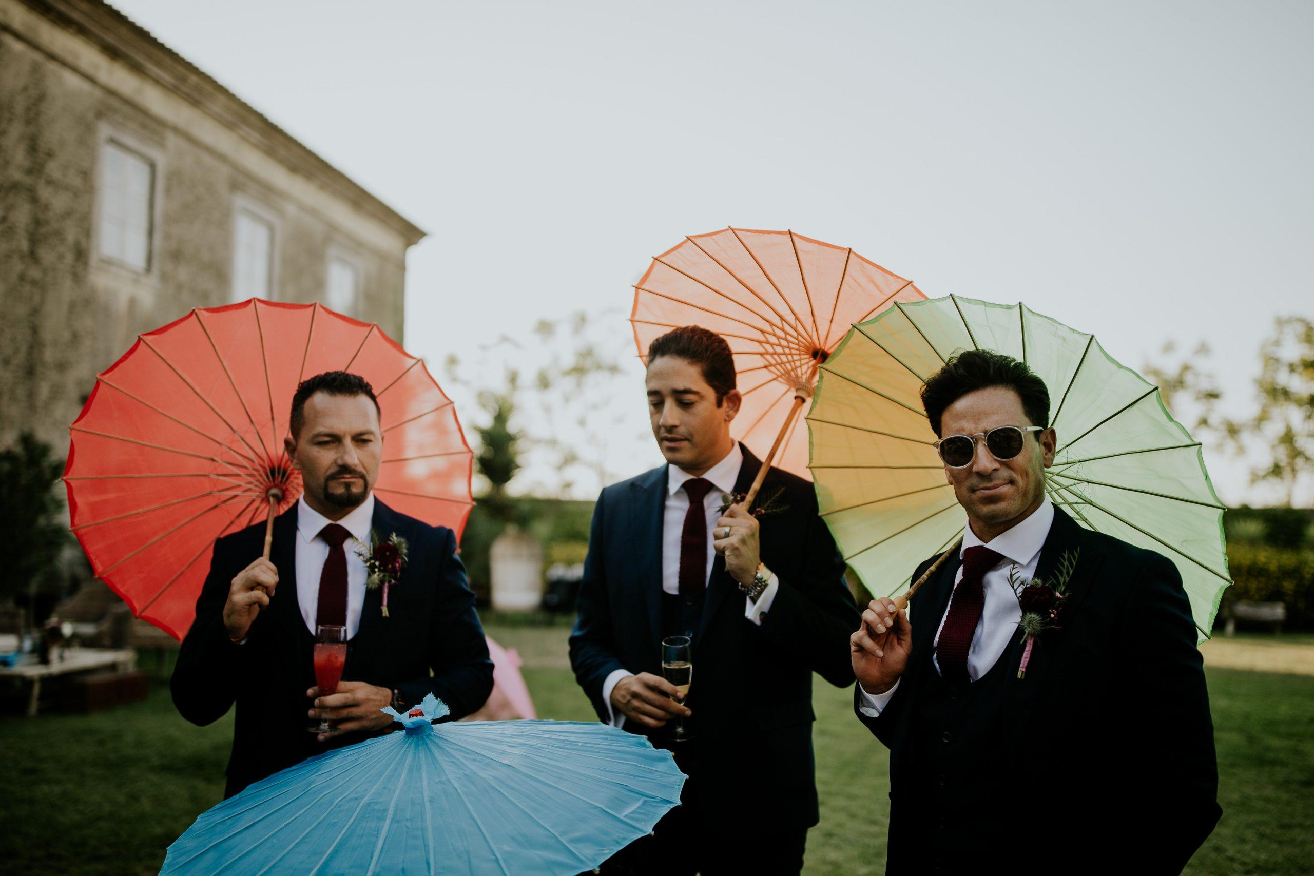 three man with colour umbrellas