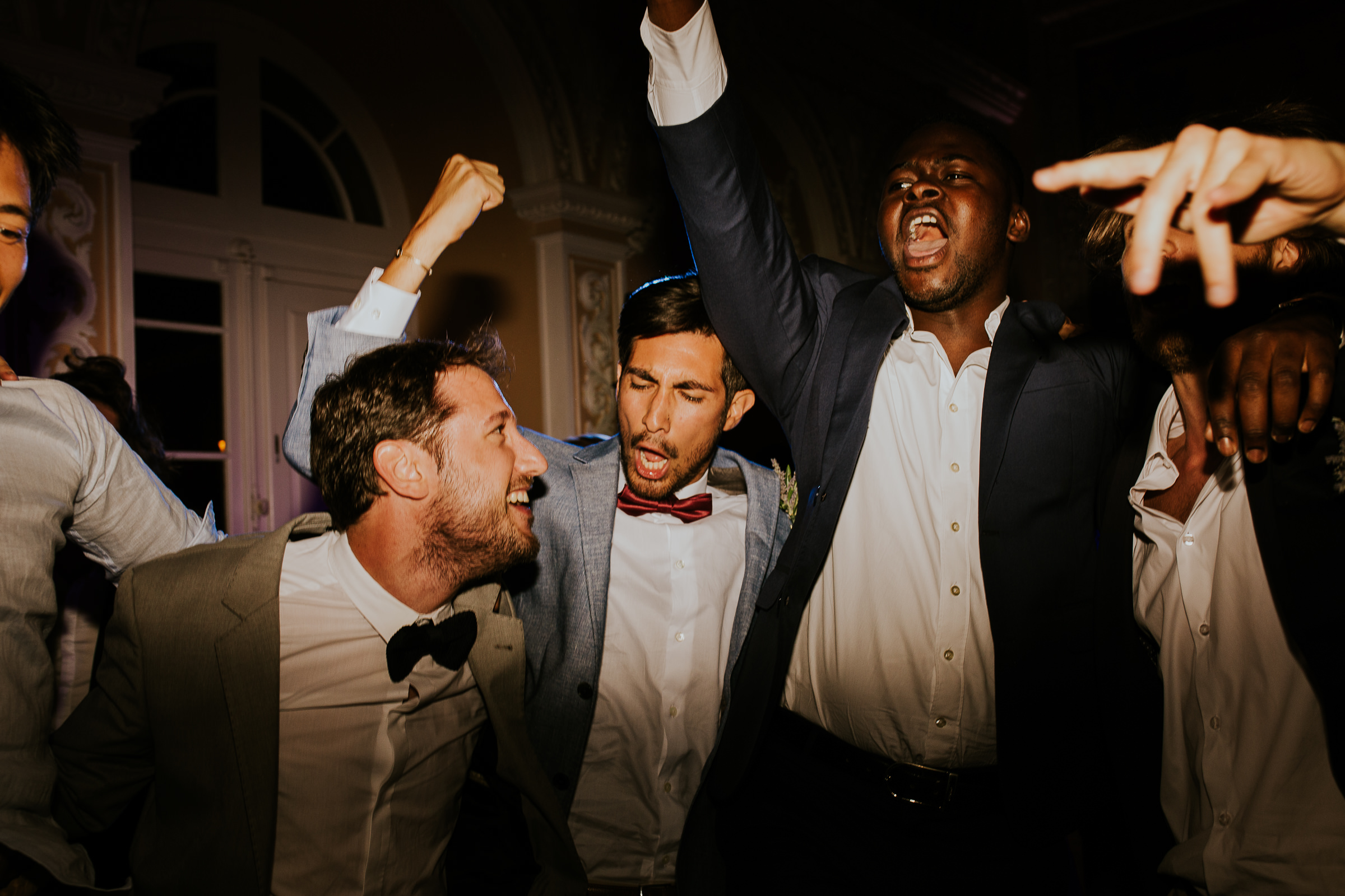 Guys partying hard in a wedding