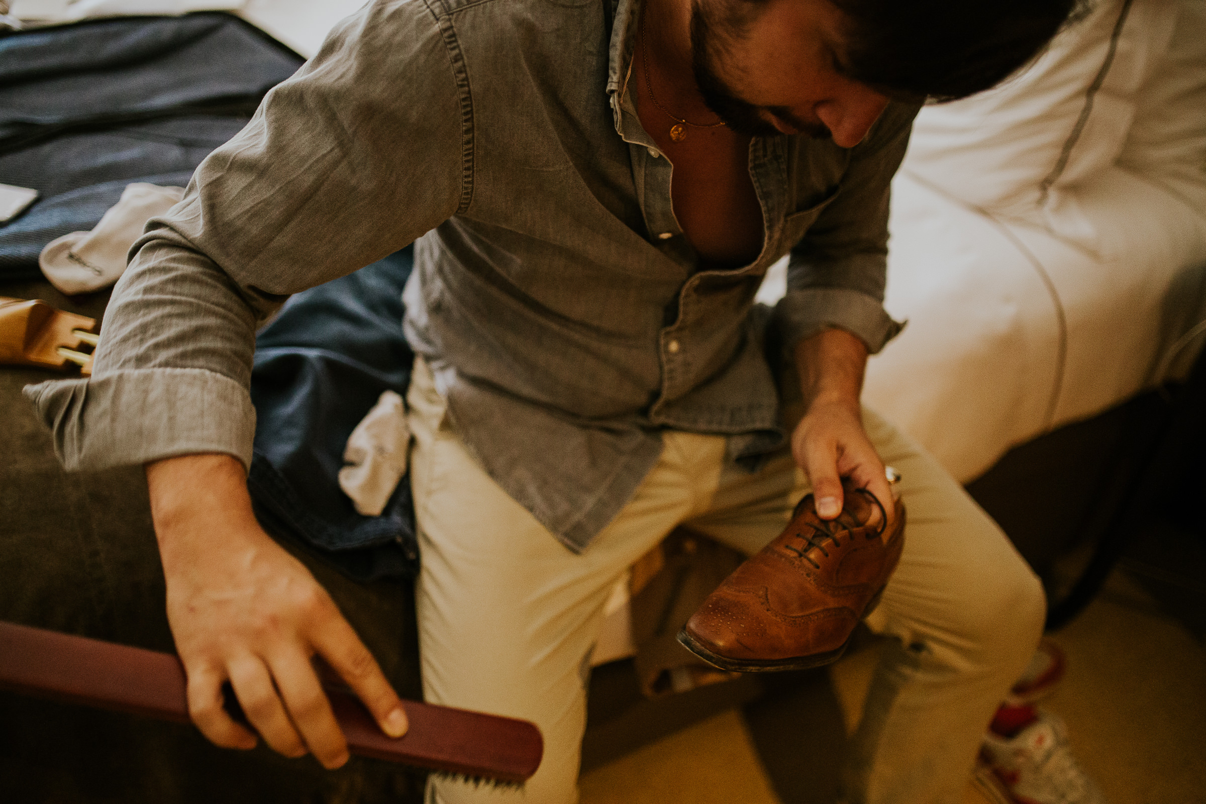 A guys rinse his leather shoes