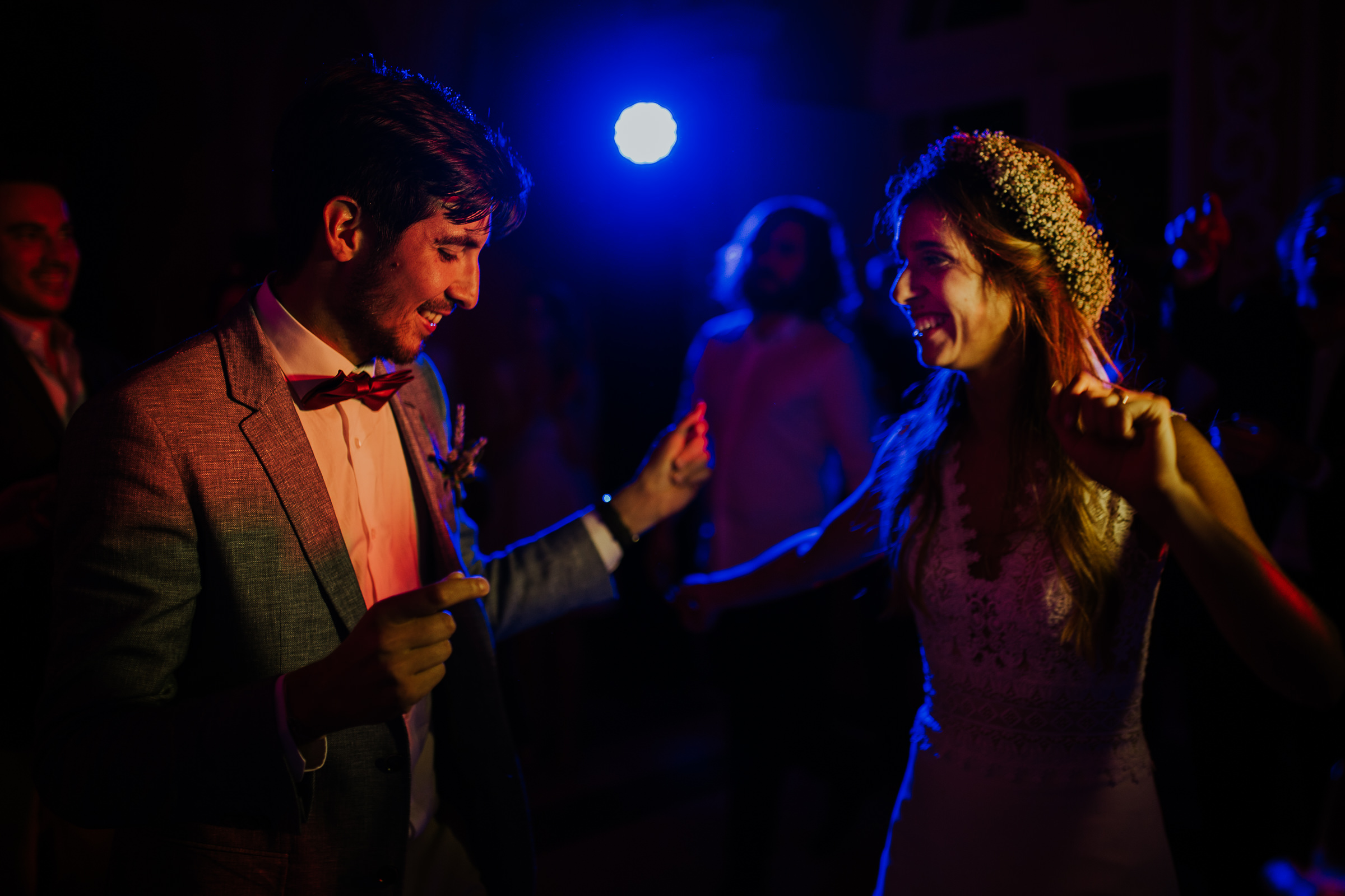 Bride and groom dancing on the wedding party at night