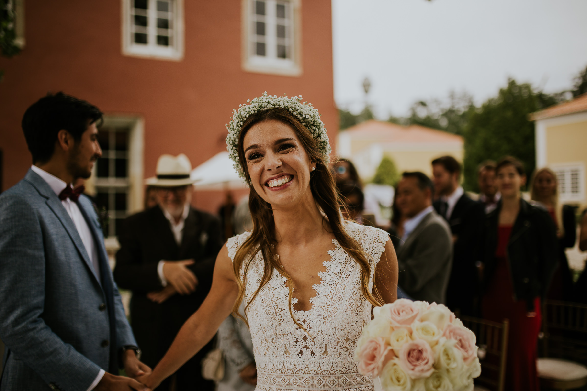 Bride smiling and taking his groom by the hand