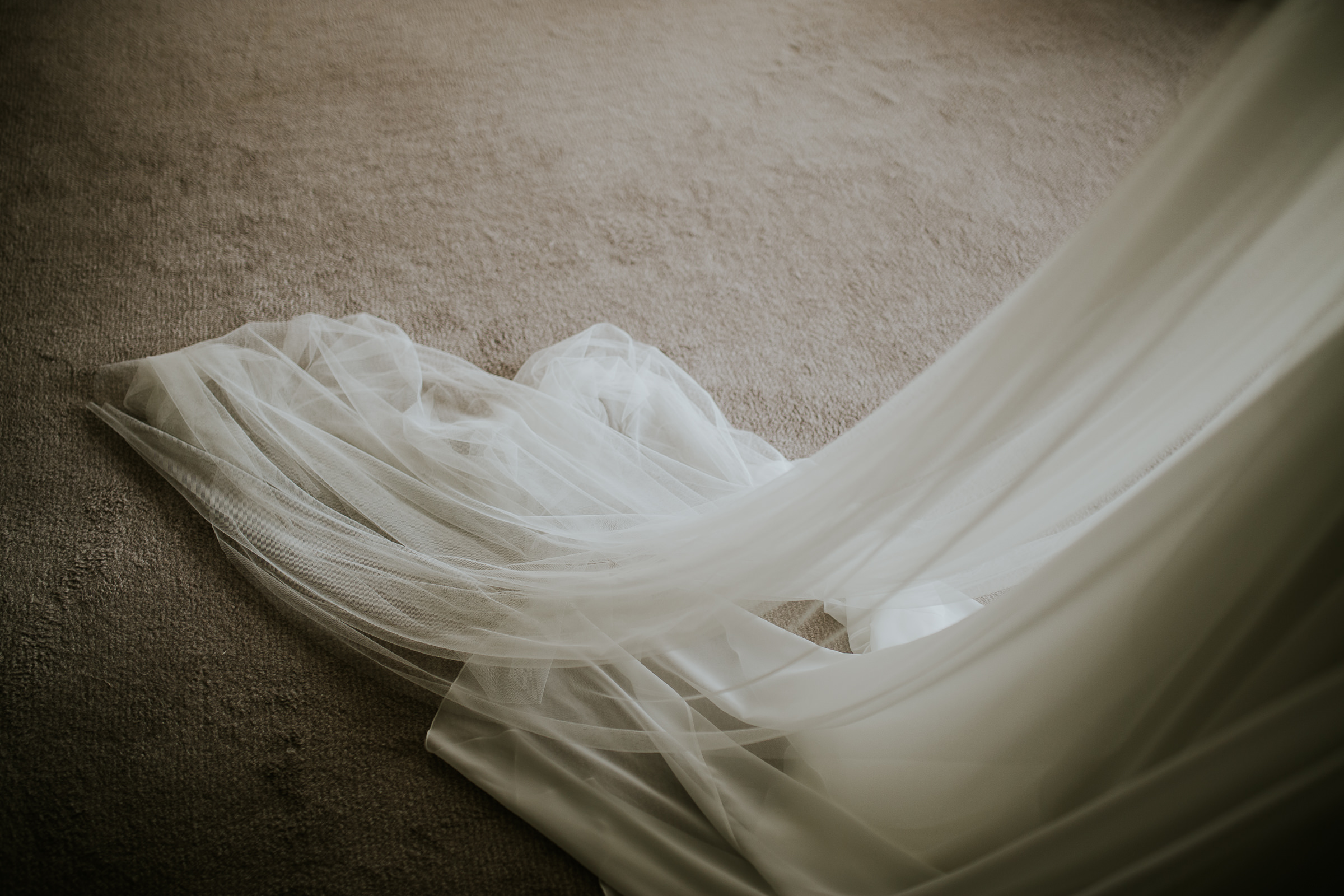 Detail of a wedding dress and the carpet