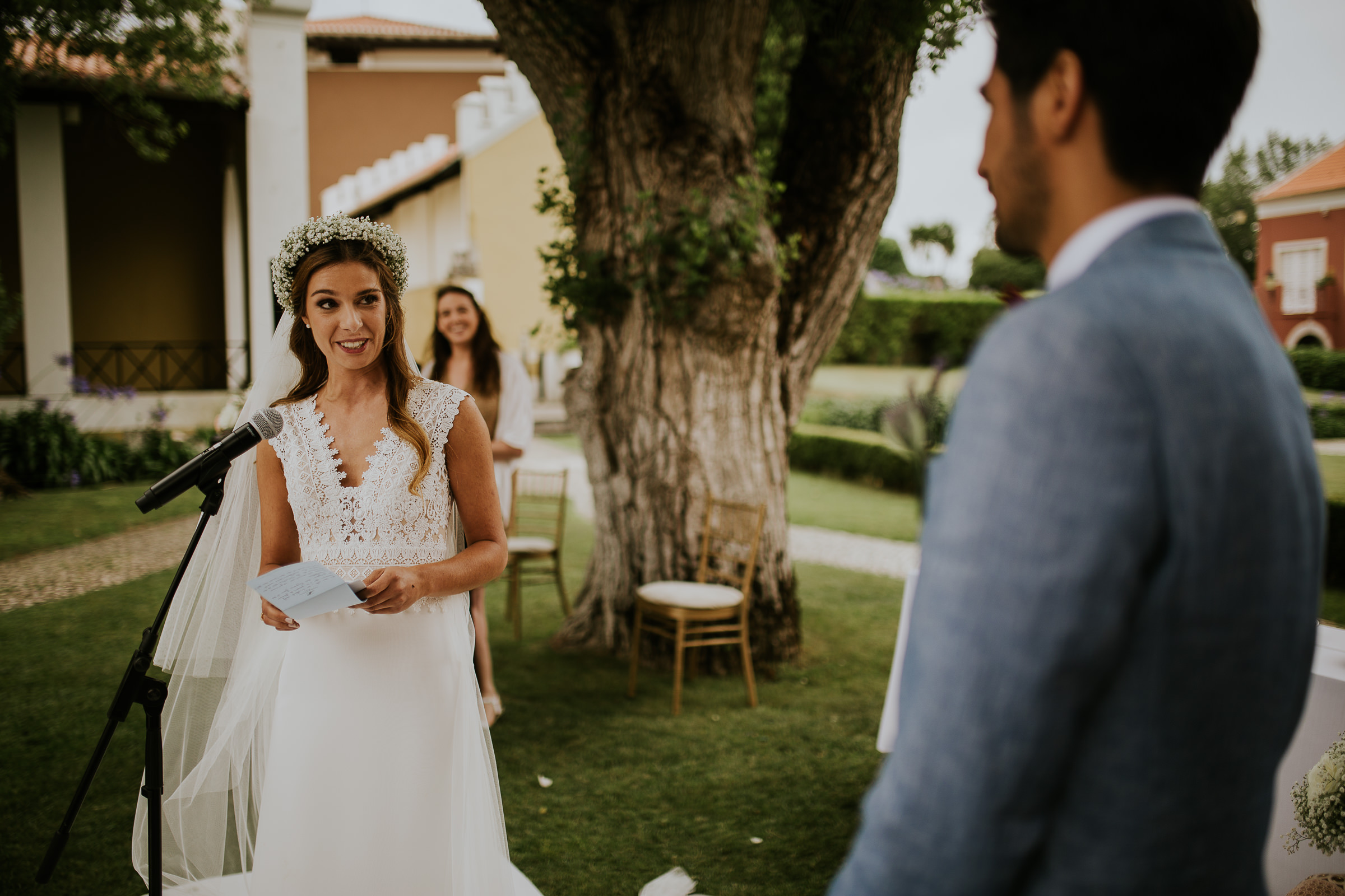 Bride reading her vows to the groom at the altar in an outdoor ceremony