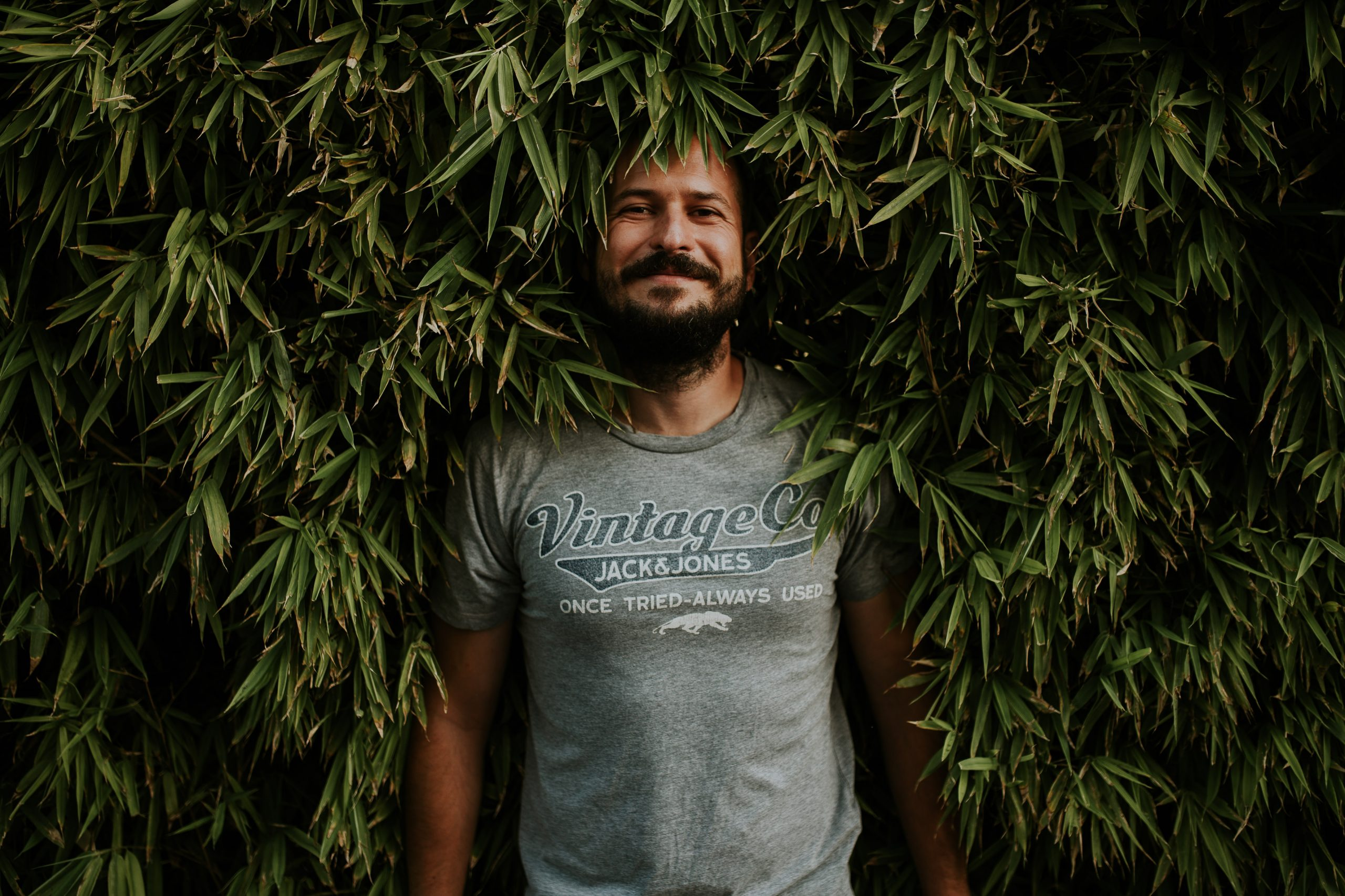 man inside the tree leaves pre weeding session in lisbon lx factory