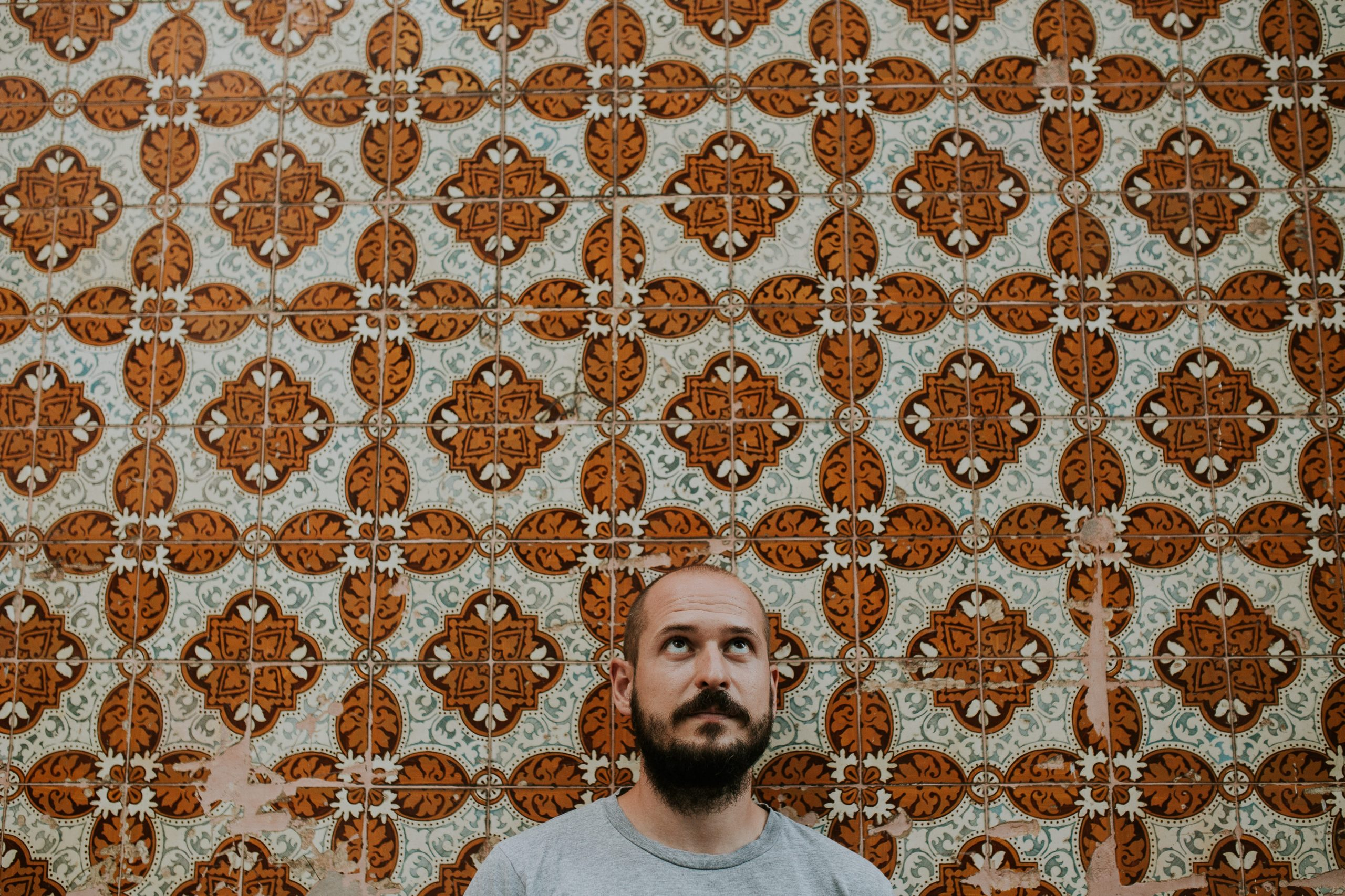 man with lisbon tiles prewedding session in portugal