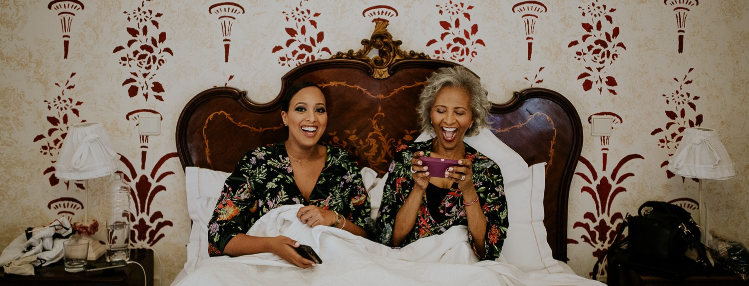 girl and mother on the bed smiling to the camera