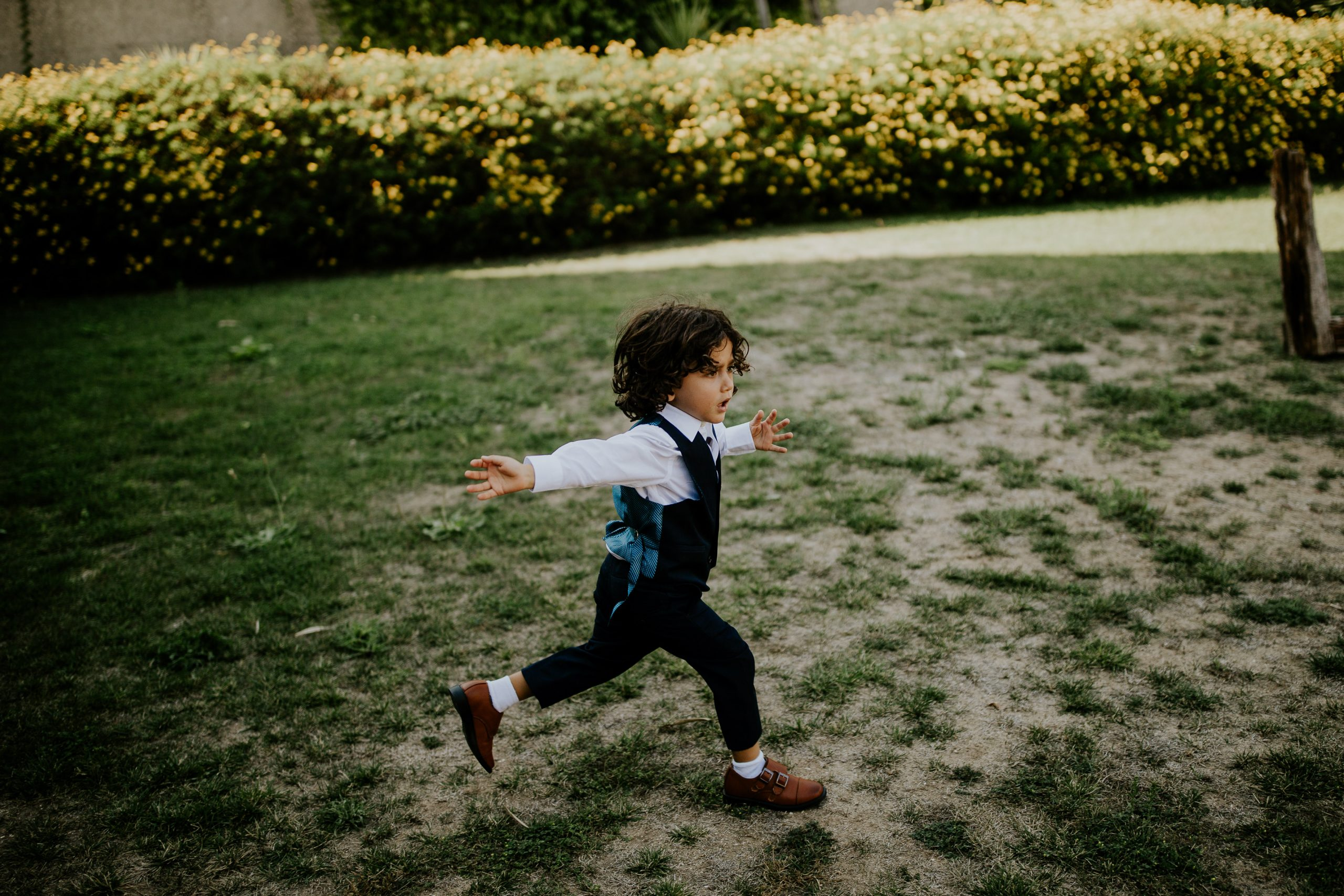 child running on a wedding party