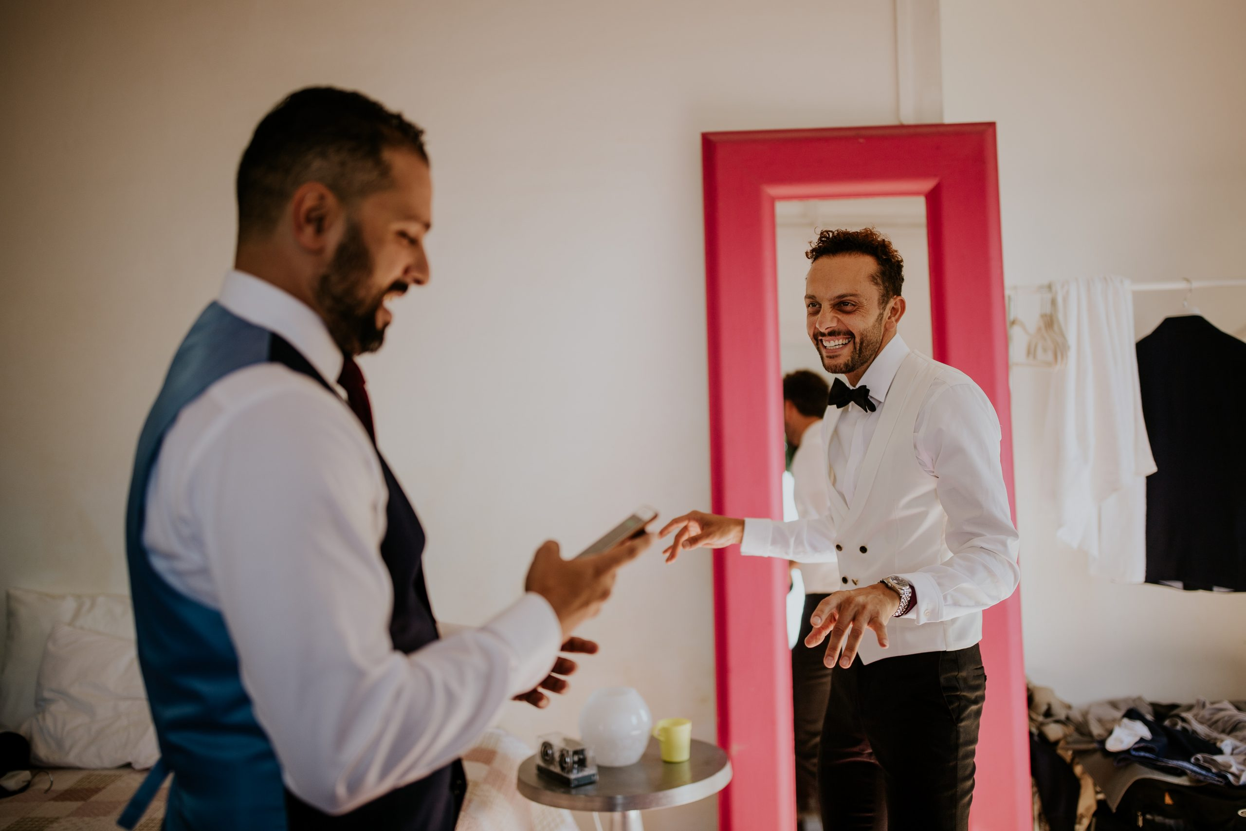 groom and best man getting ready on a wedding