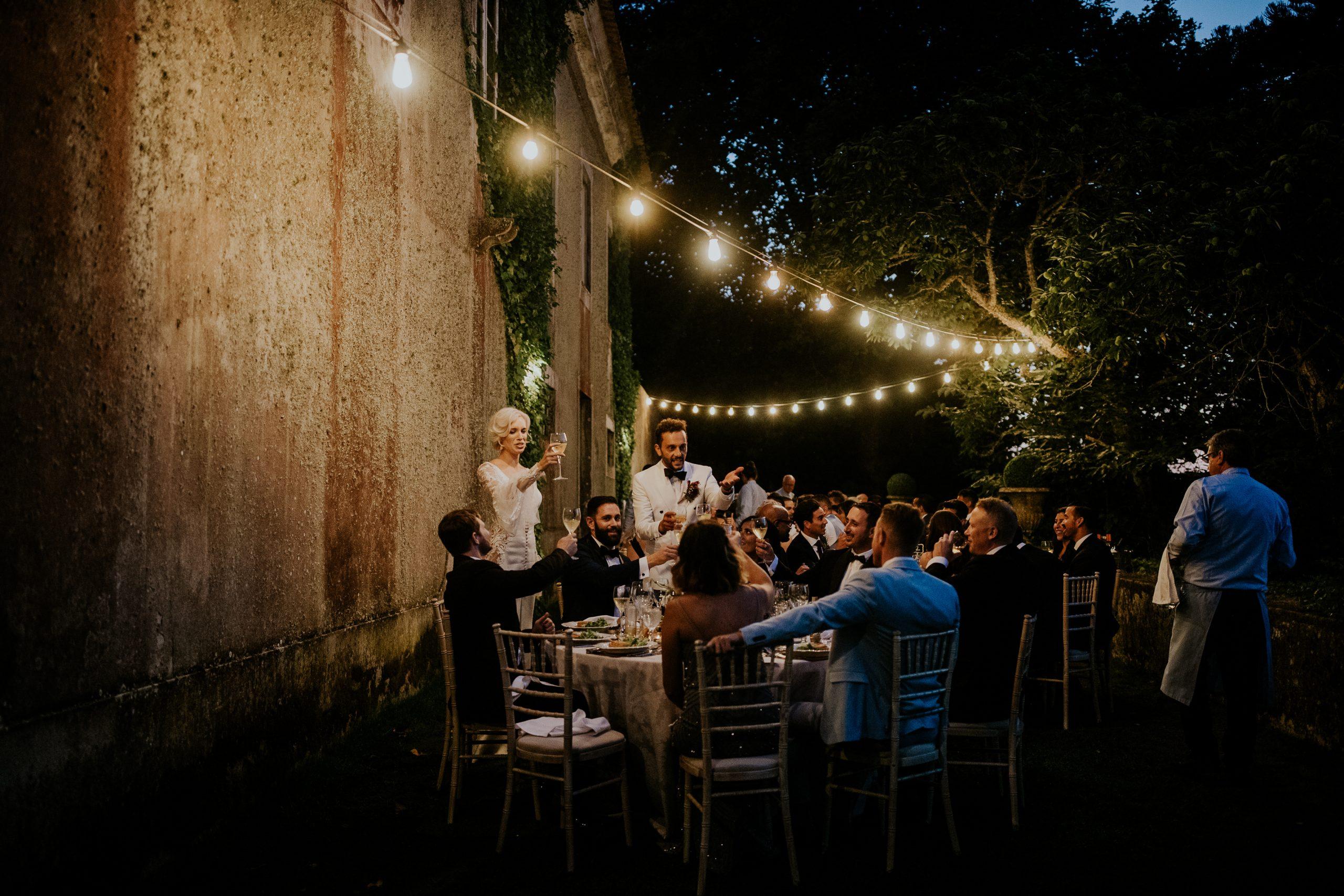 toast at a wedding dinner at night