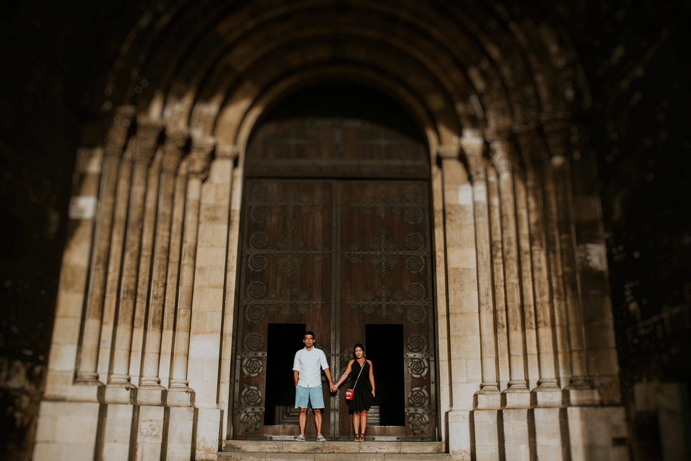 two couple in front of a church in lisbon