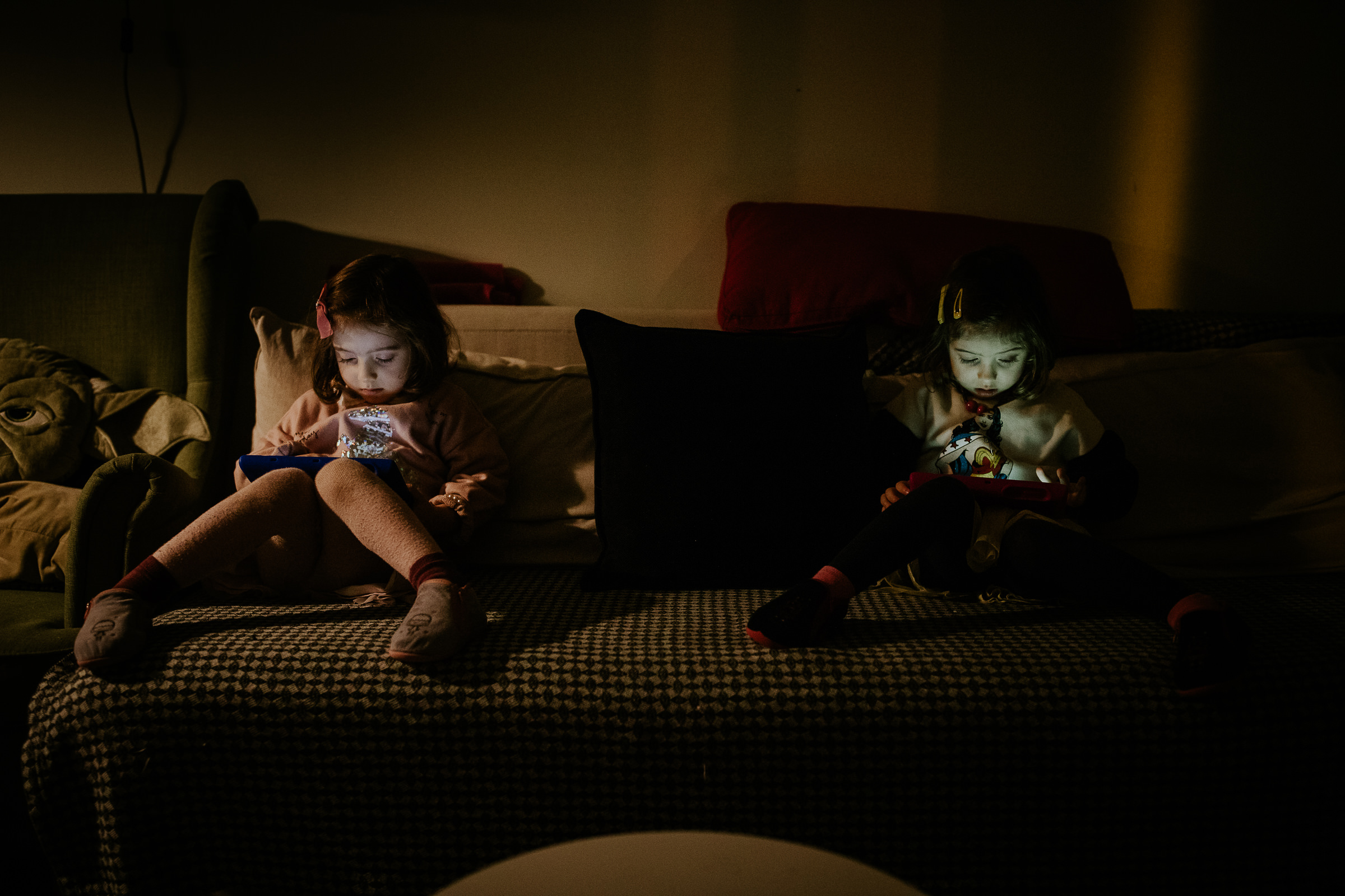 twins playing the mobile phone in the dark