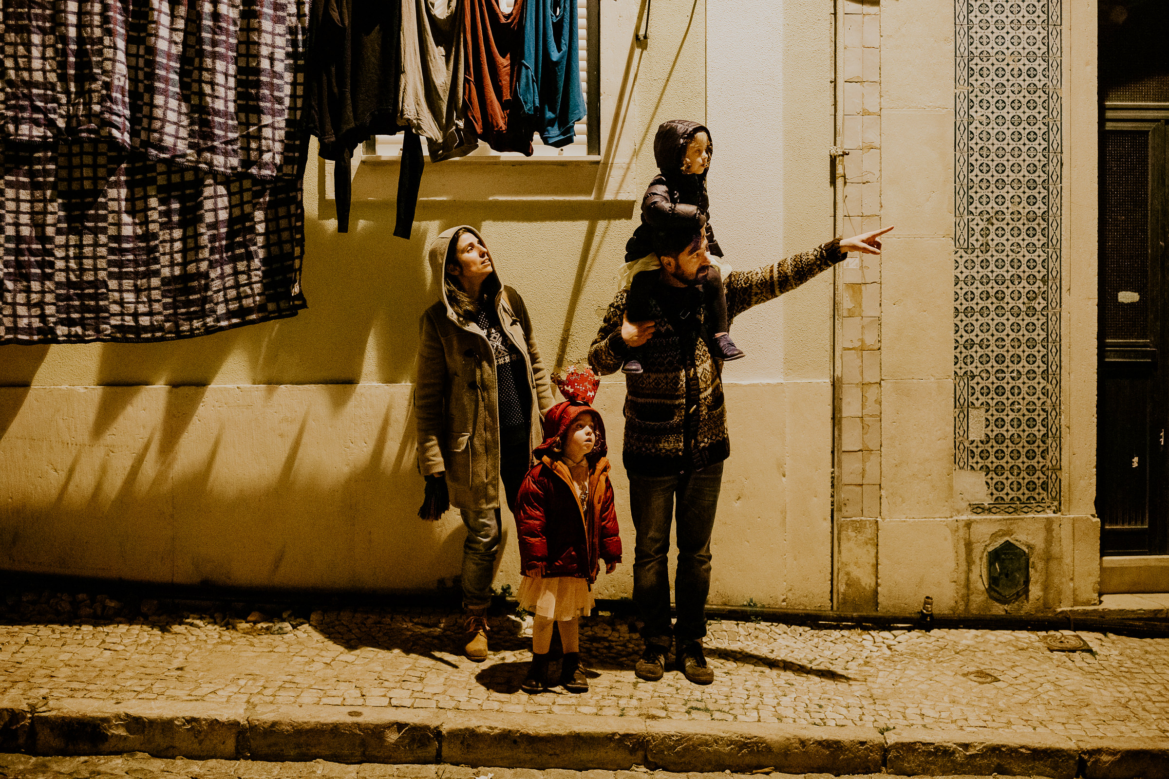 portuguese family in lisbon streets at night