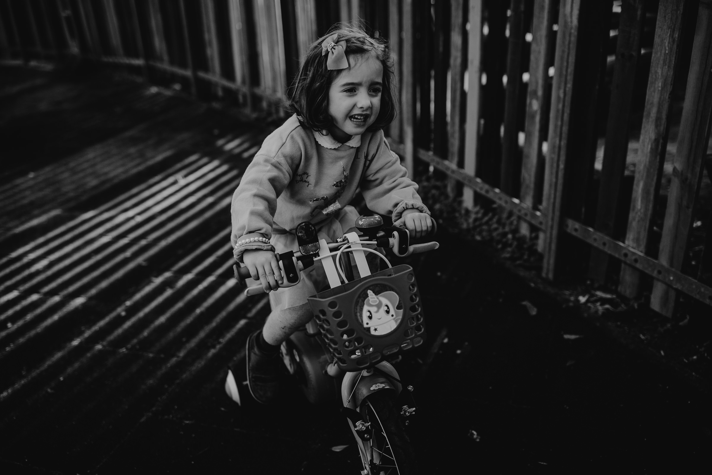 sad little girl riding a bike at the park