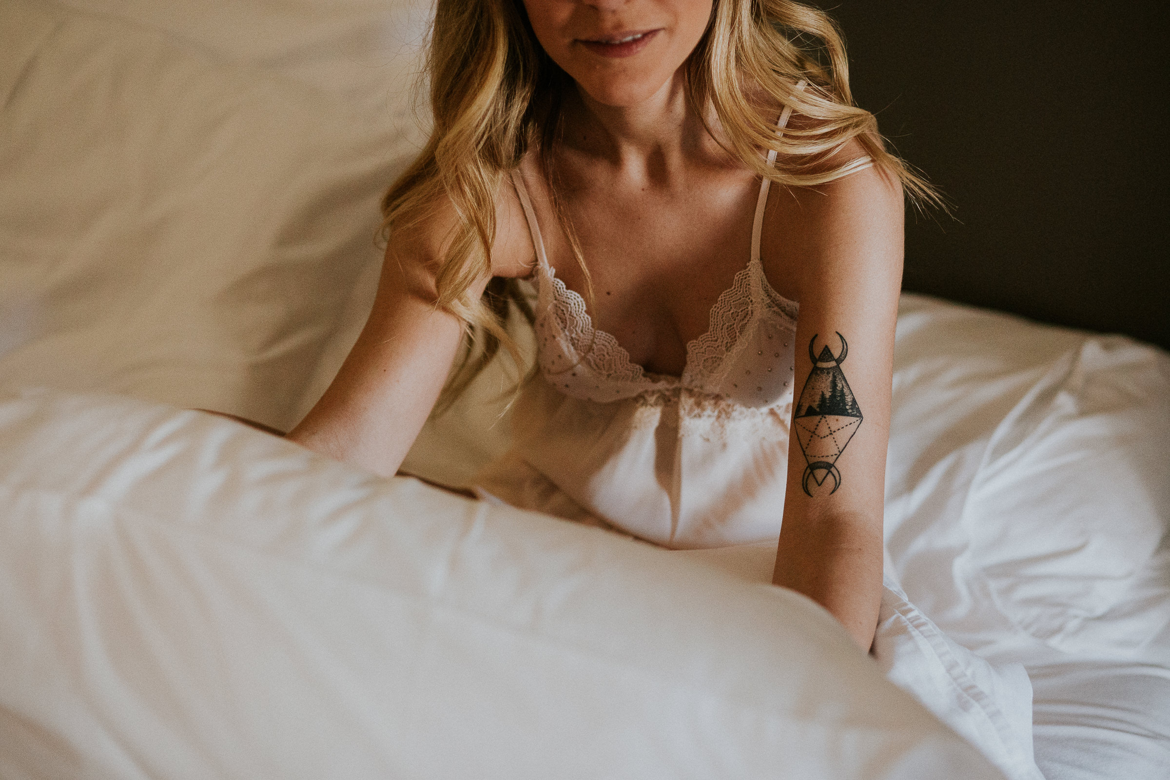 boho chic bride in lingerie on her bed