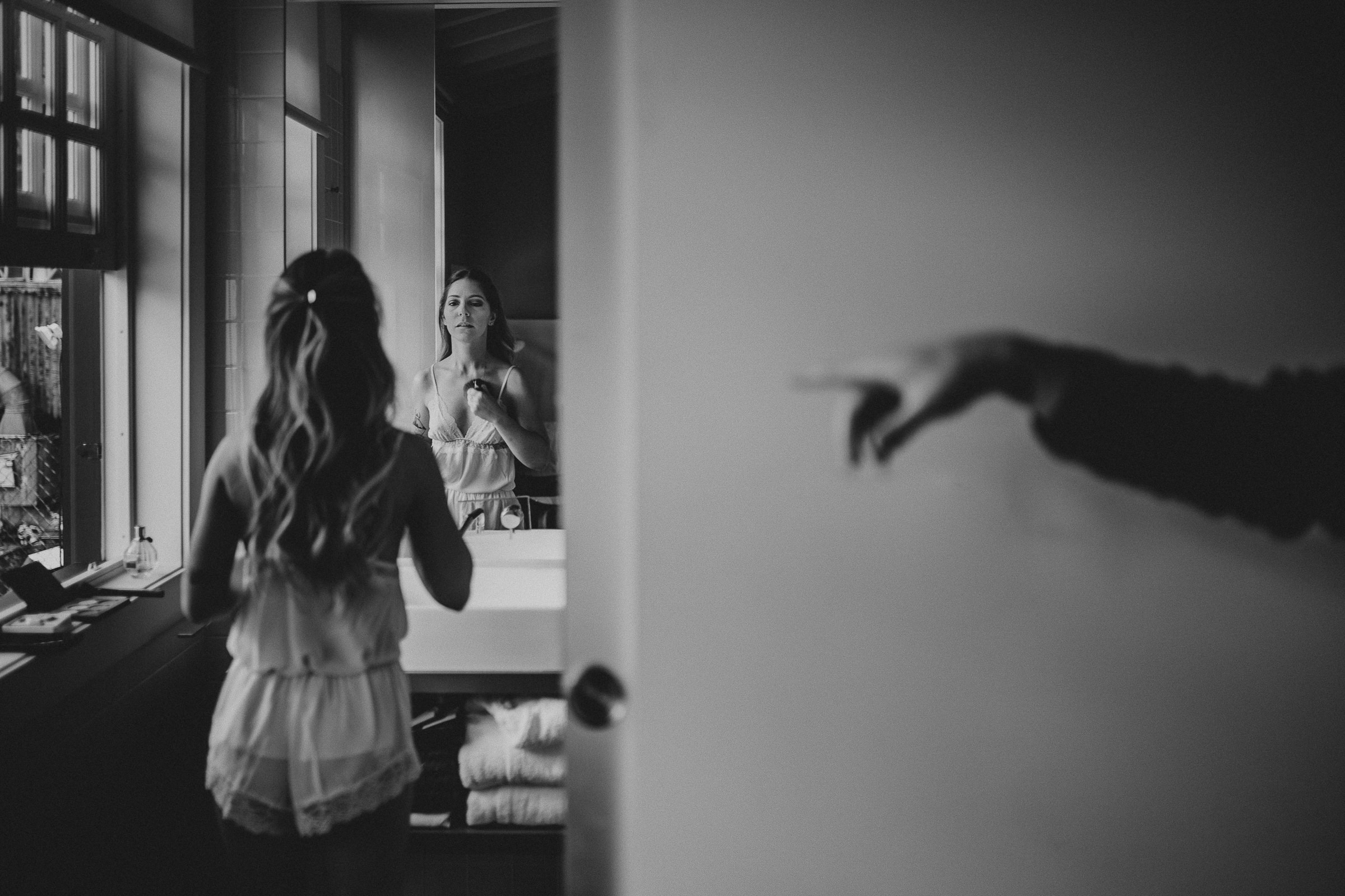 boho chic bride preparation looking on the mirror