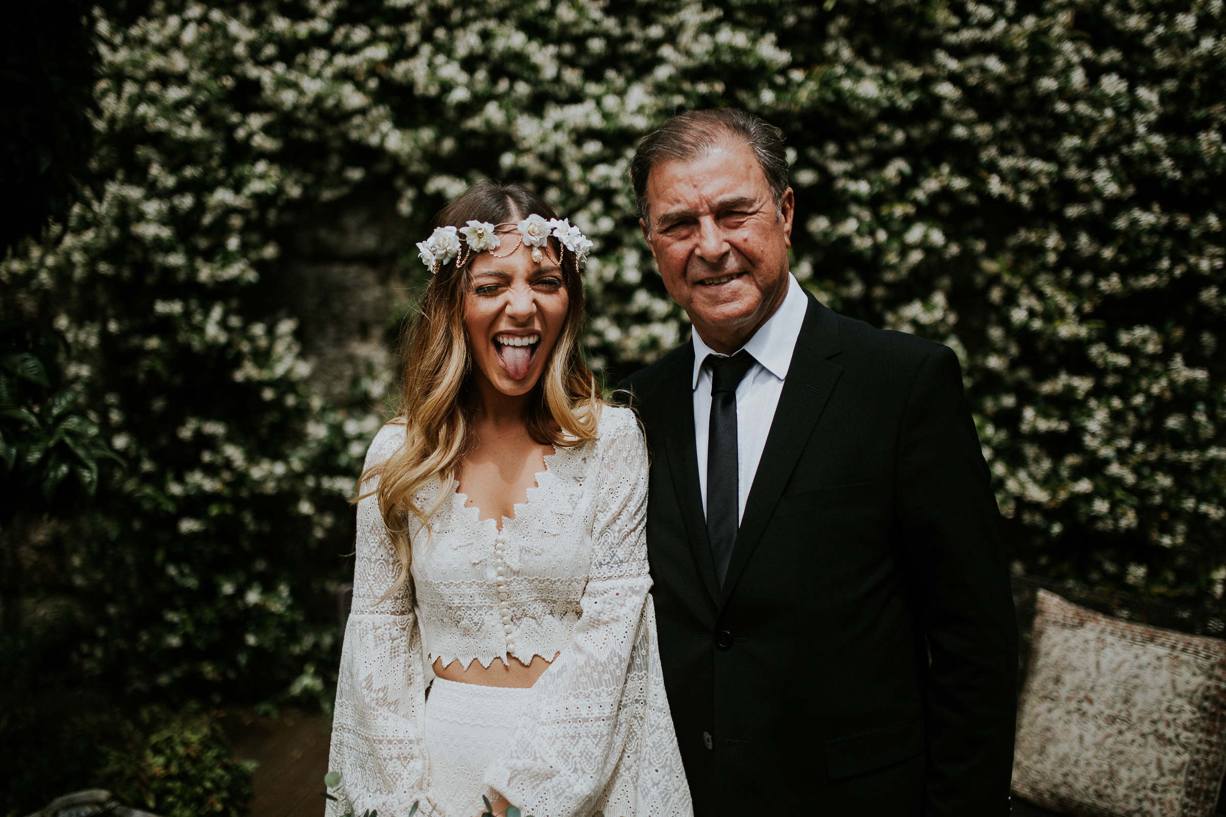 boho chic bride and her father smiling to the camera