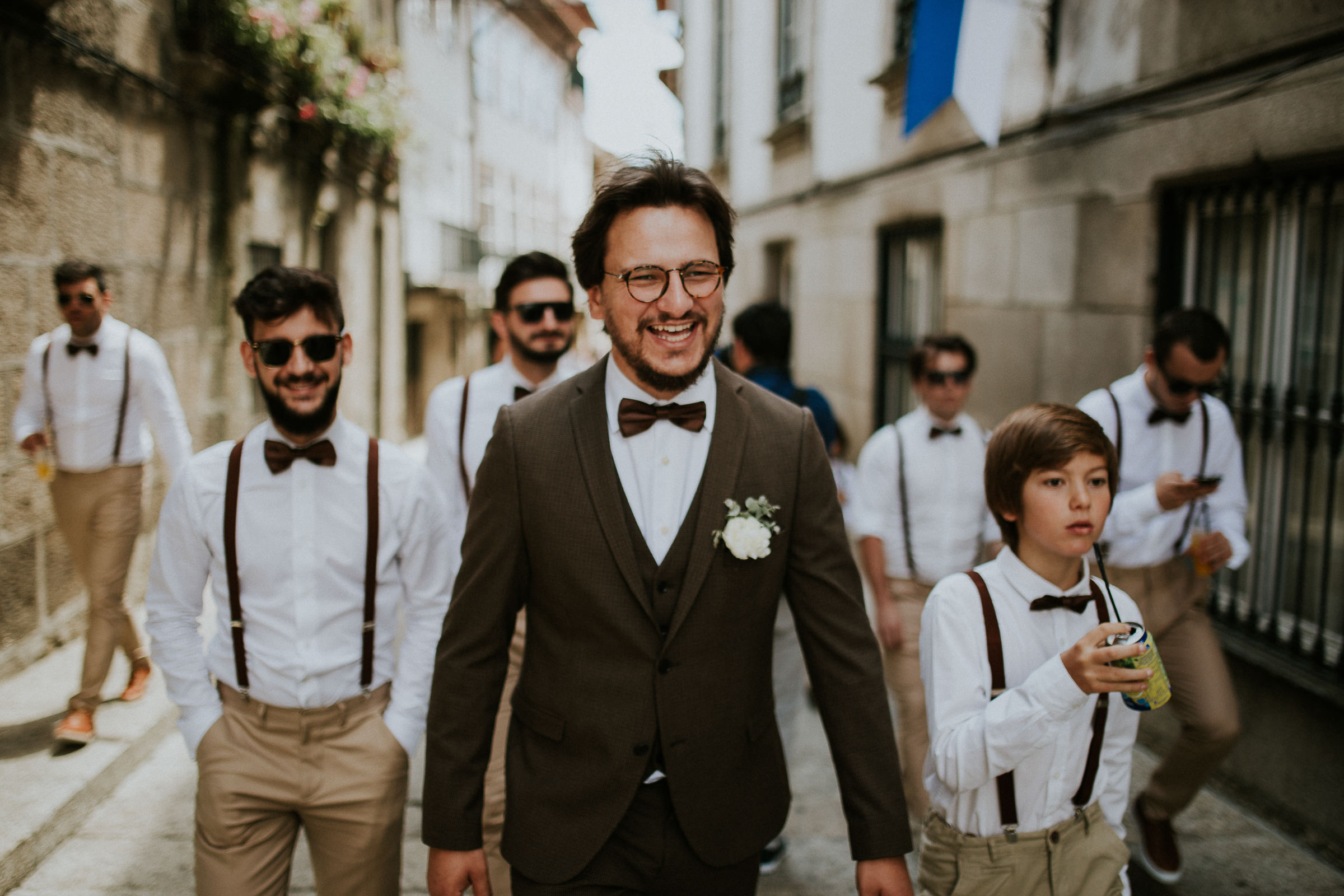 boho chic groom and bestmen walking in the city streets