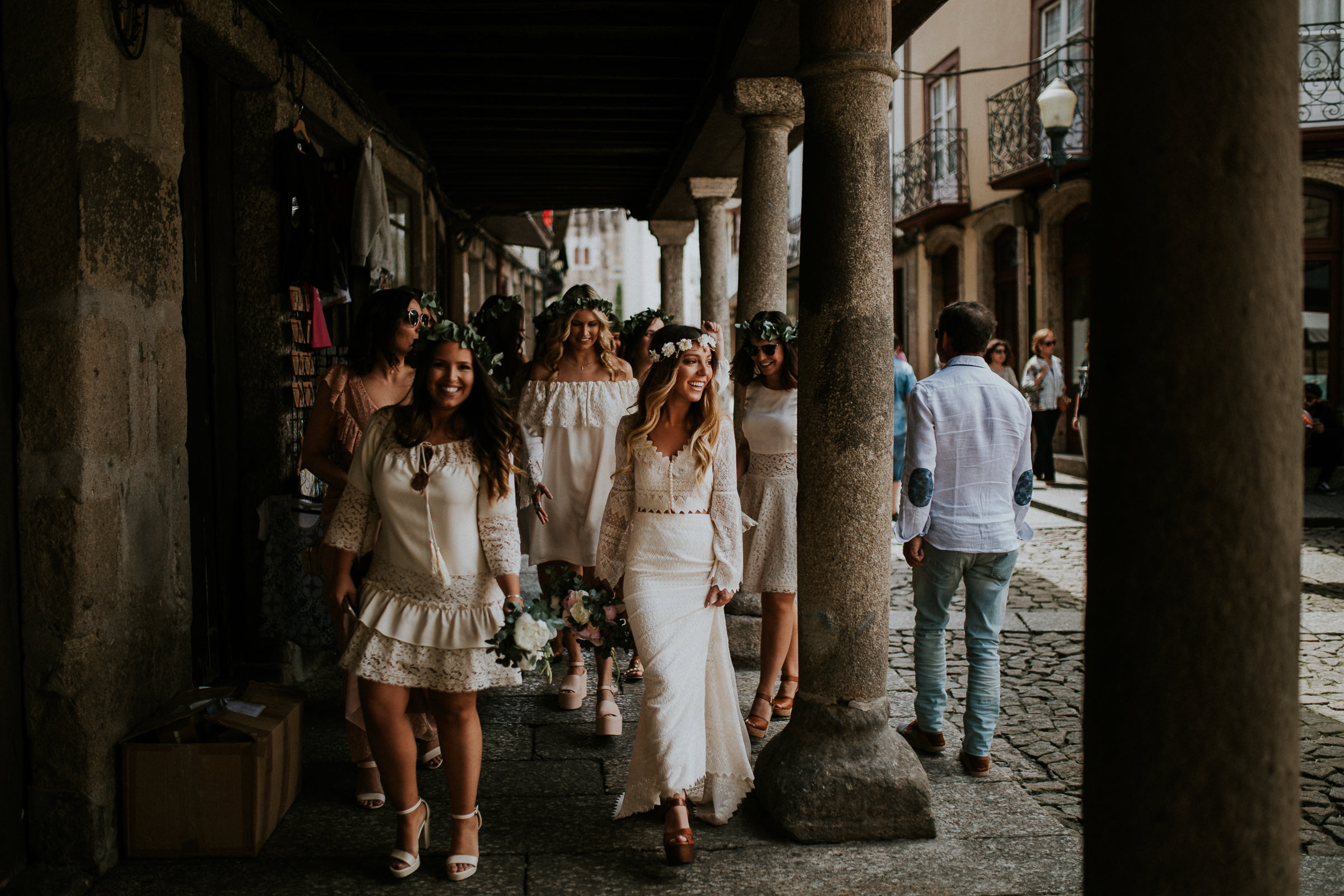 boho chic bride and bridesmaids walking in the city streets