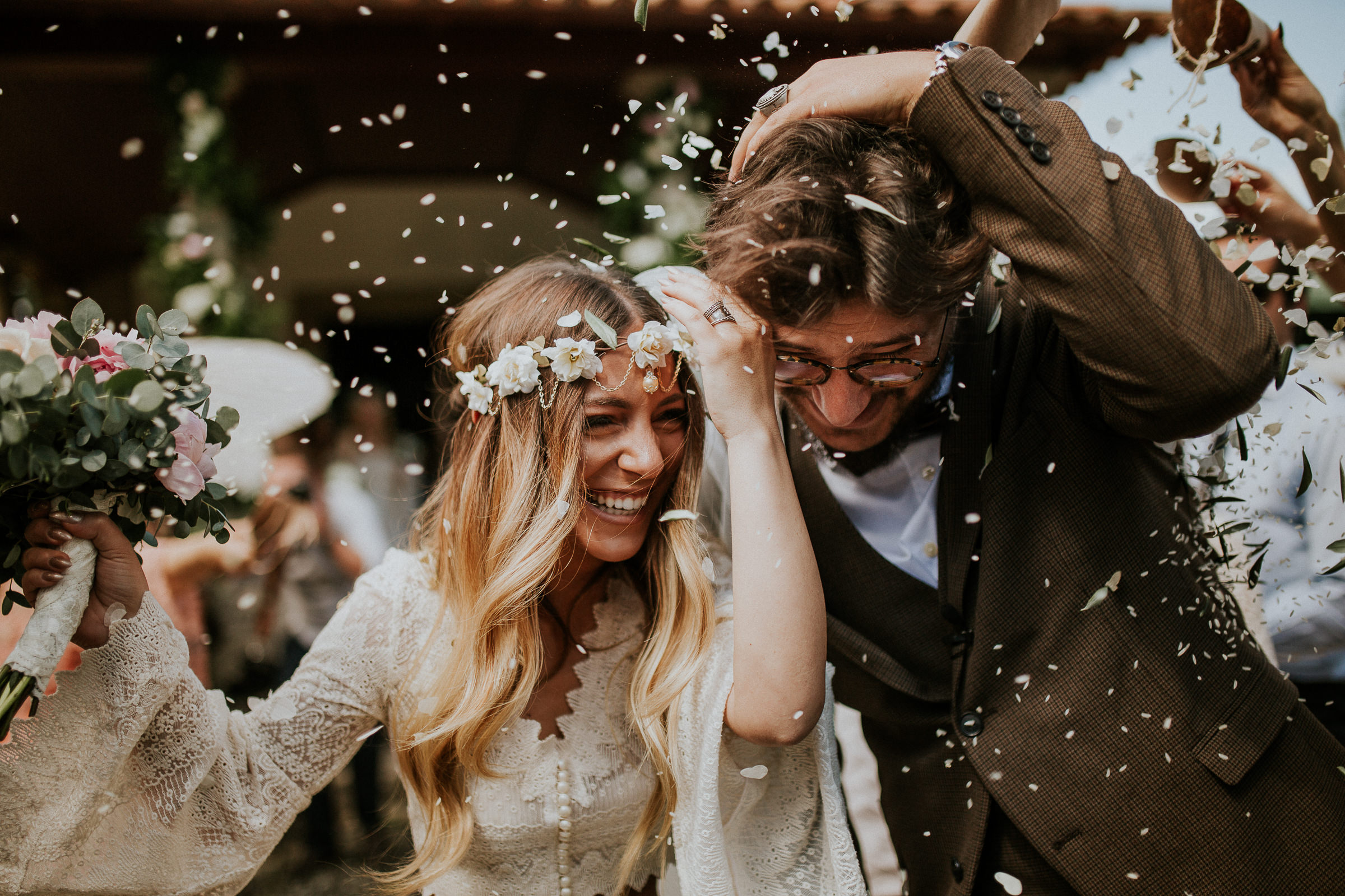 boho chic bride and groom smilling happy after the ceremony