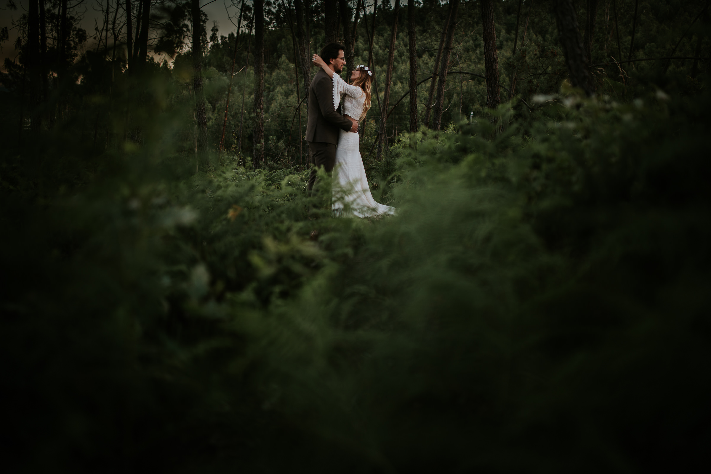 bride and groom in the woods during their session