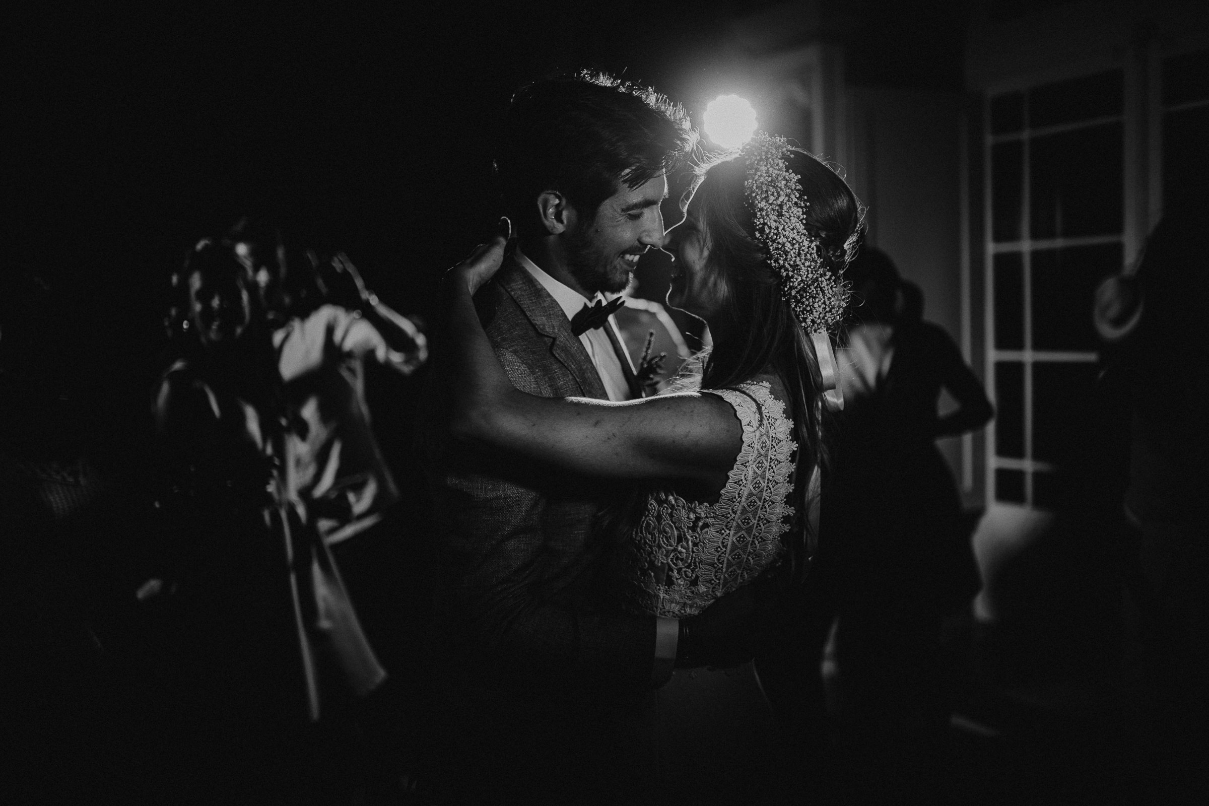 Couple smiling and facing each other with back light