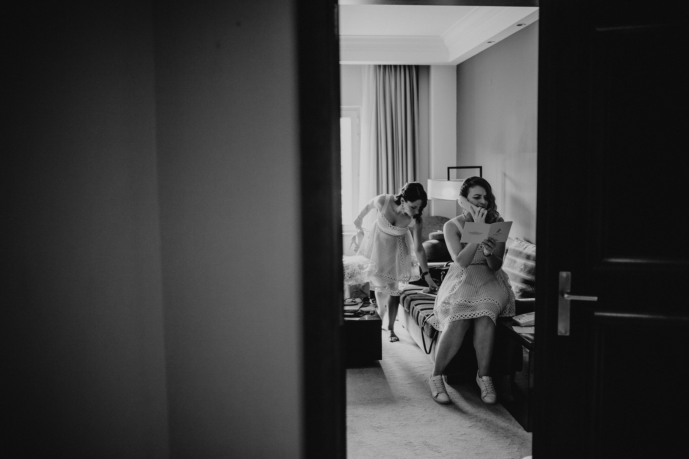 Bridesmaids with vintage look in an hotel room ordering food by phone
