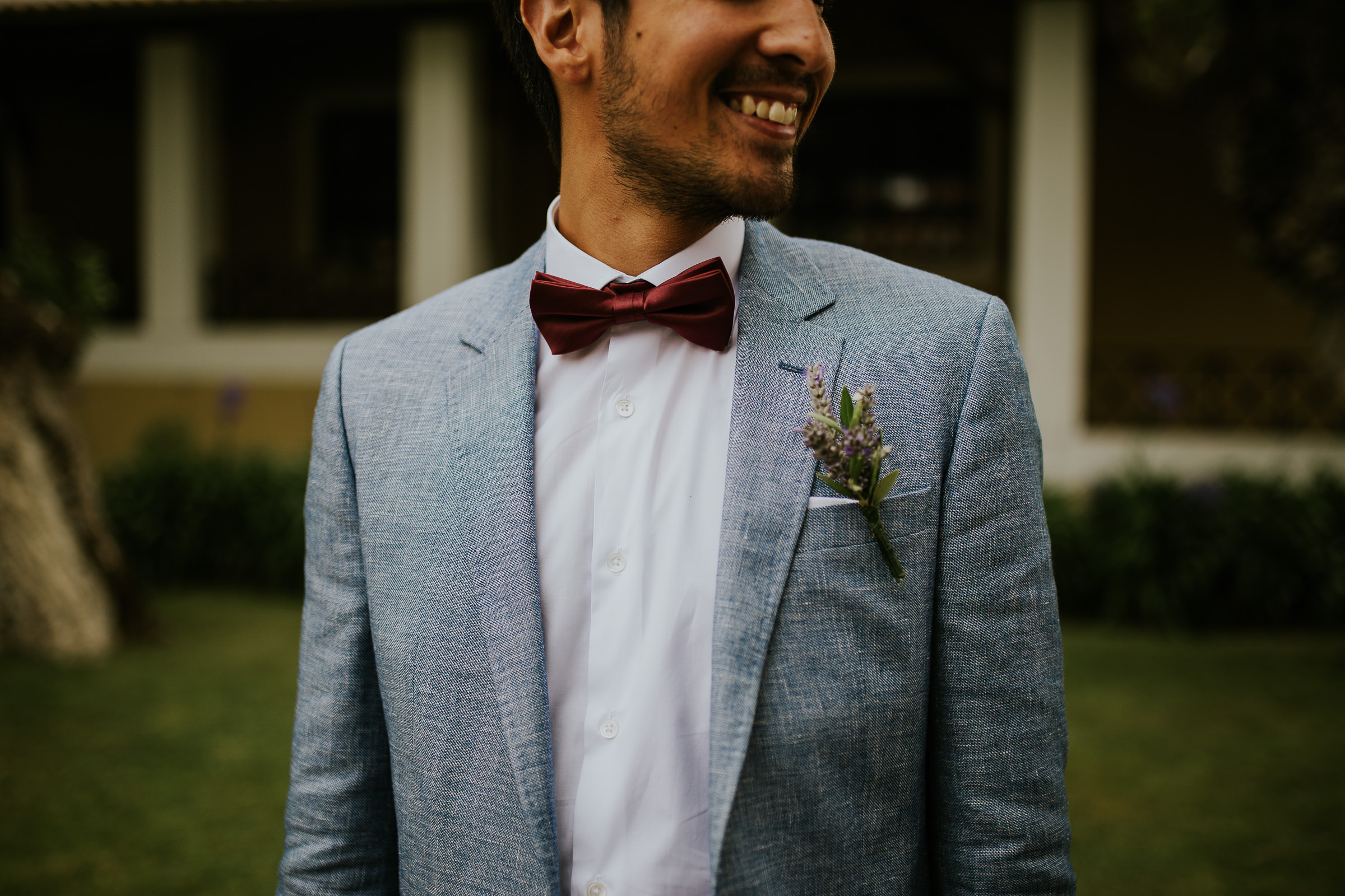 Cropped portrait of the grooms smile and his wedding outfit